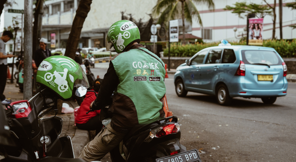 an Indonesian startup Gojek driver waiting for a passenger