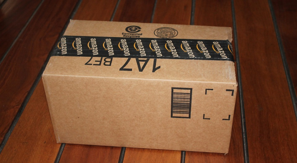 Amazon package on wooden floor