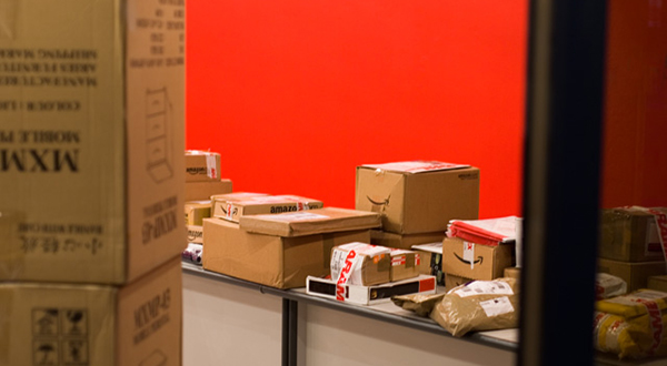 Red room with packages on a counter