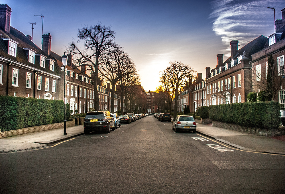 Cars parked on quiet residential street in London