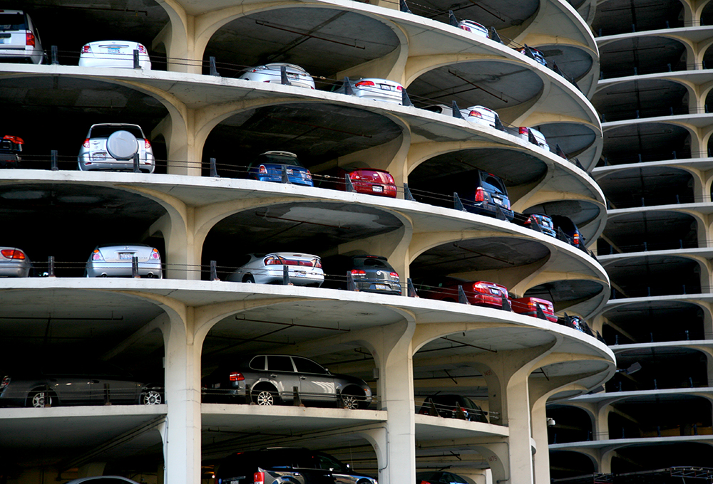 Cars parked in open-air spiraling parking garage
