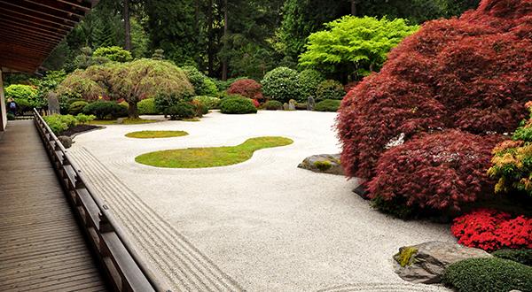 Wooden walkway next to Japanese stone garden