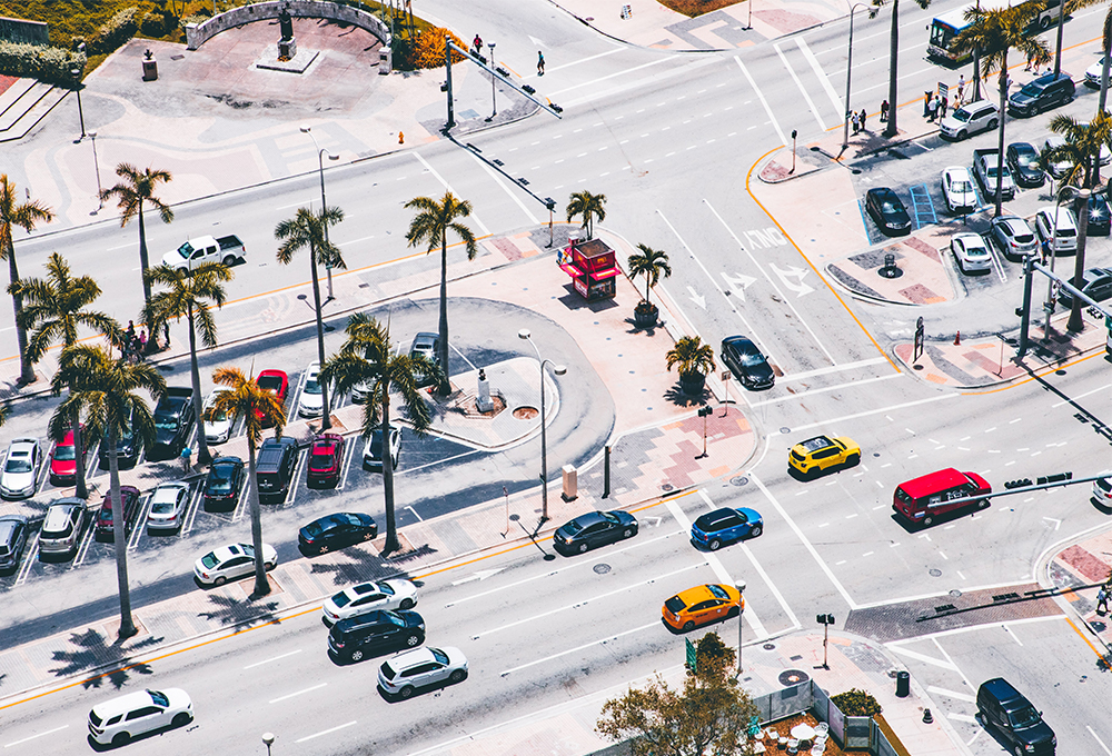 Aerial view of multi-lane roads and parking at intersection in Miami