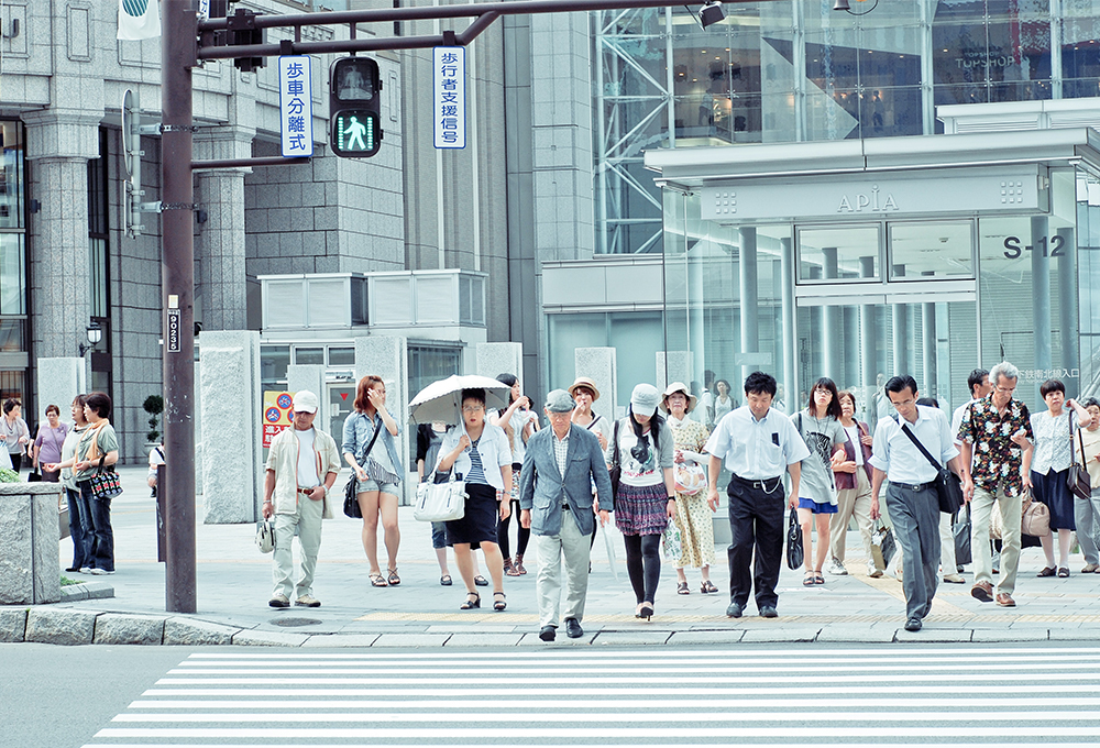 Group of people crossing a street in Sapporo, Japan