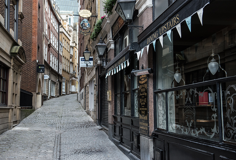 Narrow winding street in front of restaurant in London