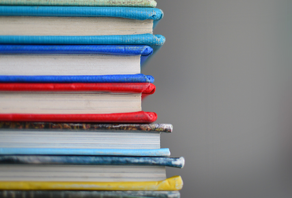 stack of books with colorful covers