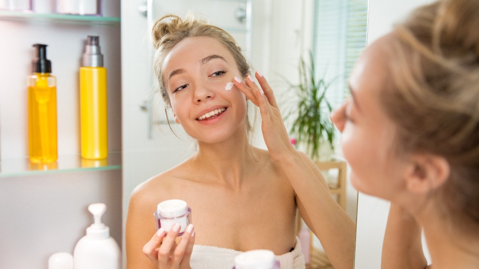 woman performing daily skin care routine