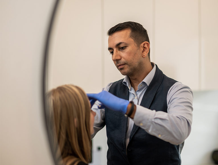 aesthetic practitioner providing skin treatment to client