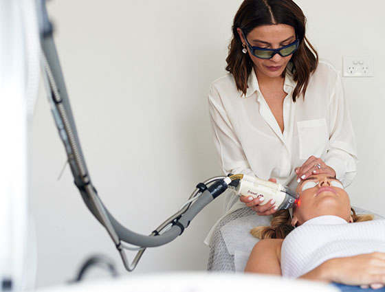dermal clinician performing scar removal treatment on client