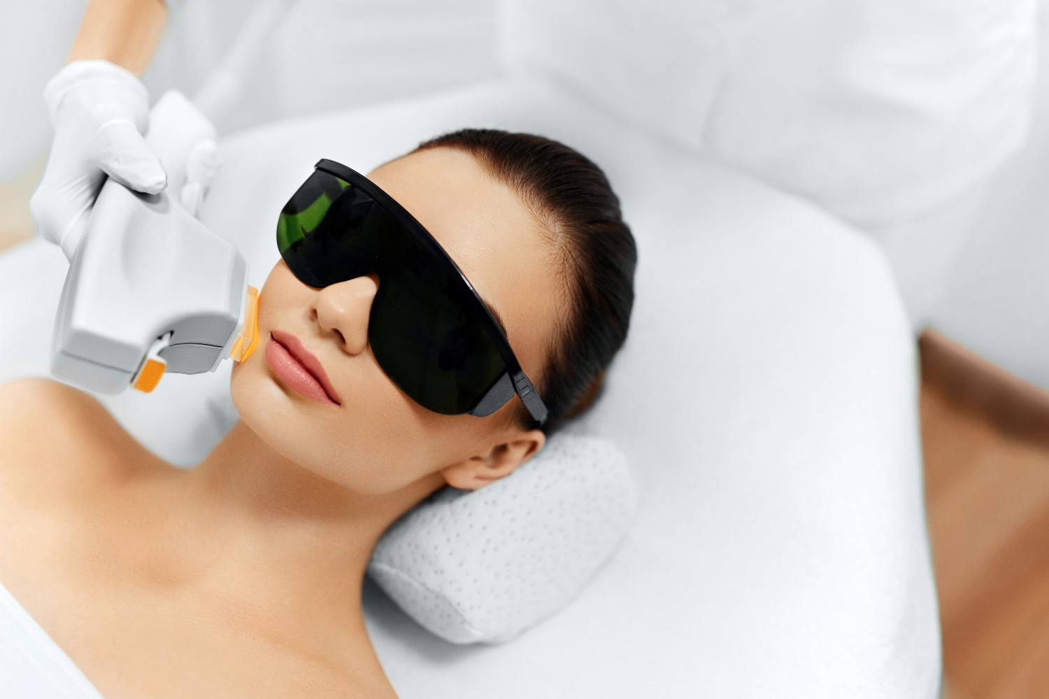 woman getting a laser treatment on her face