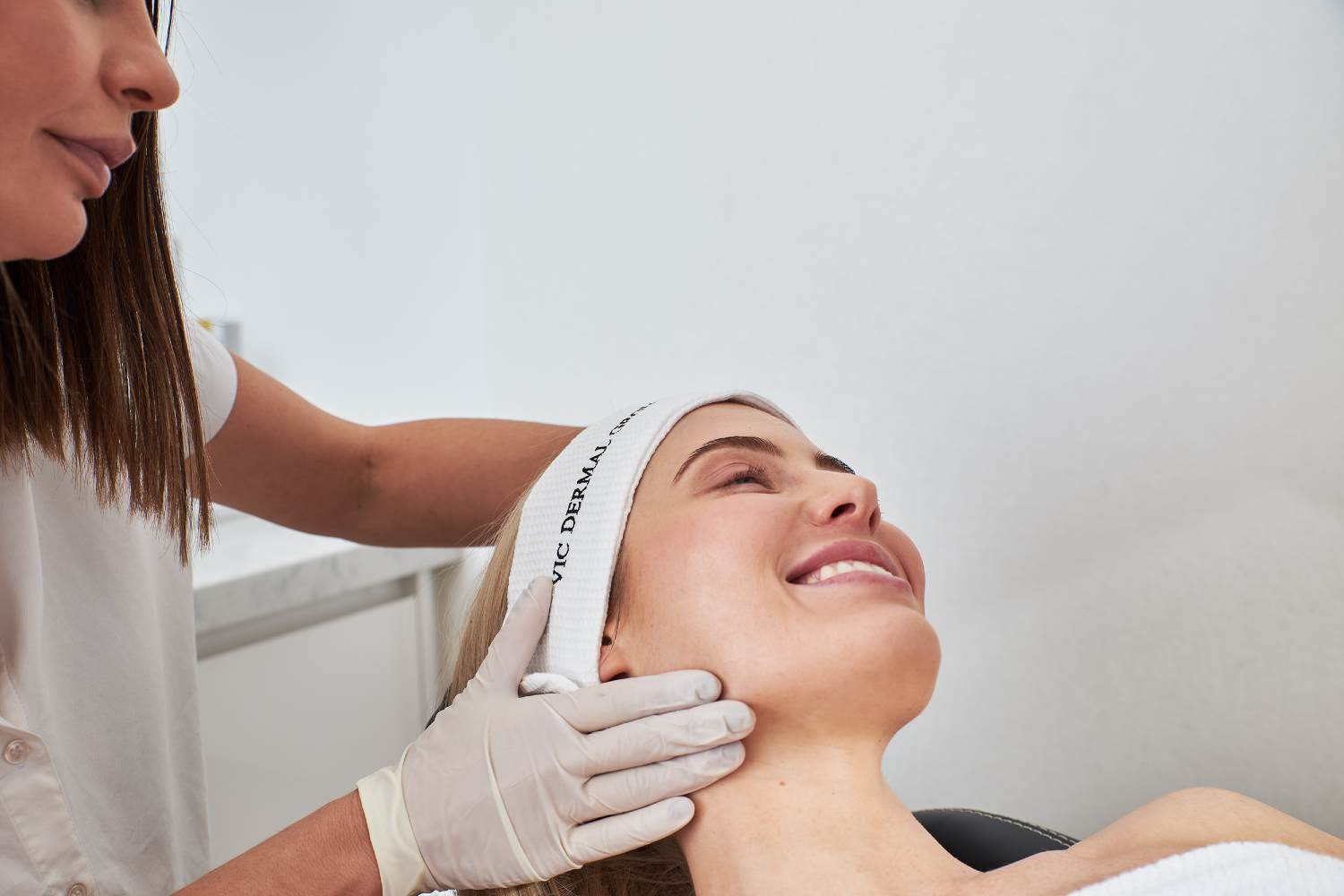 women getting a chemical peel treatment administered