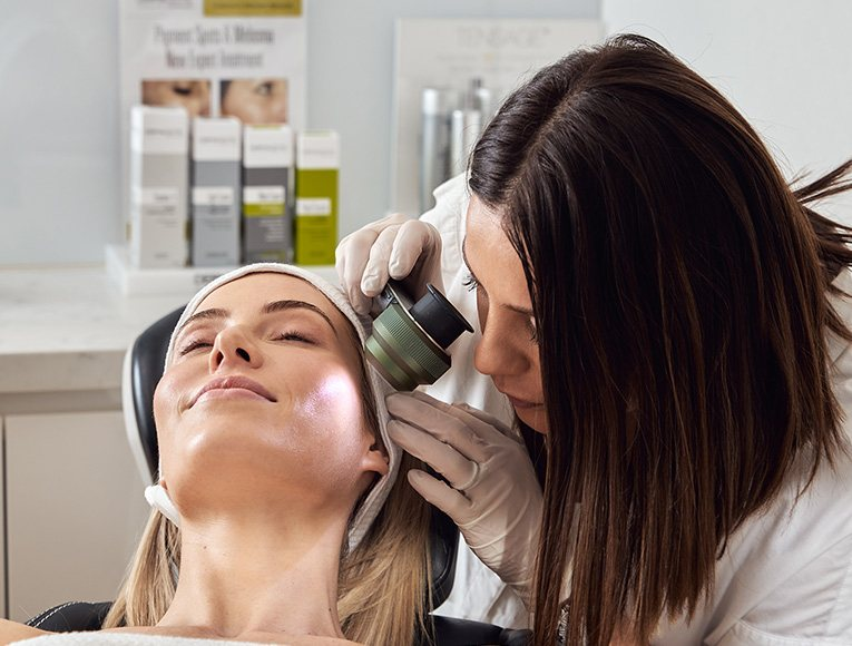 dermal clinician looking at patient's skin