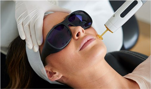 client lying down in chair receiving a skin treatment procedure