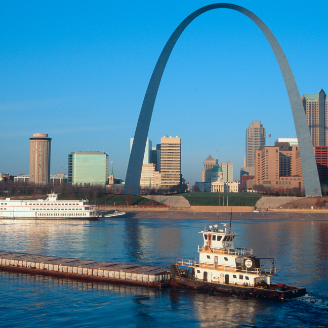 Gateway Arch National Park and Downtown view with a ferry on Mississippi River