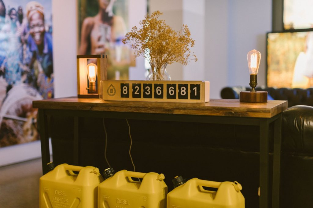 at charity: water's New York headquarters, a yellow numerical counter shows the number of people that charity: water has helped.