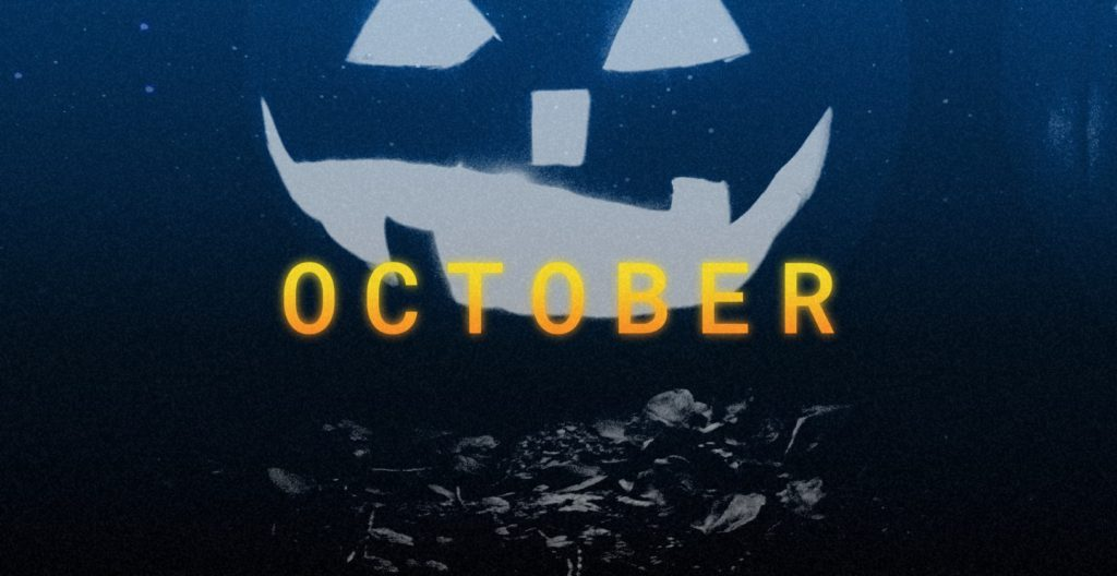 Gray image of a jack-o-lantern with the word October in yellow in the middle of the image