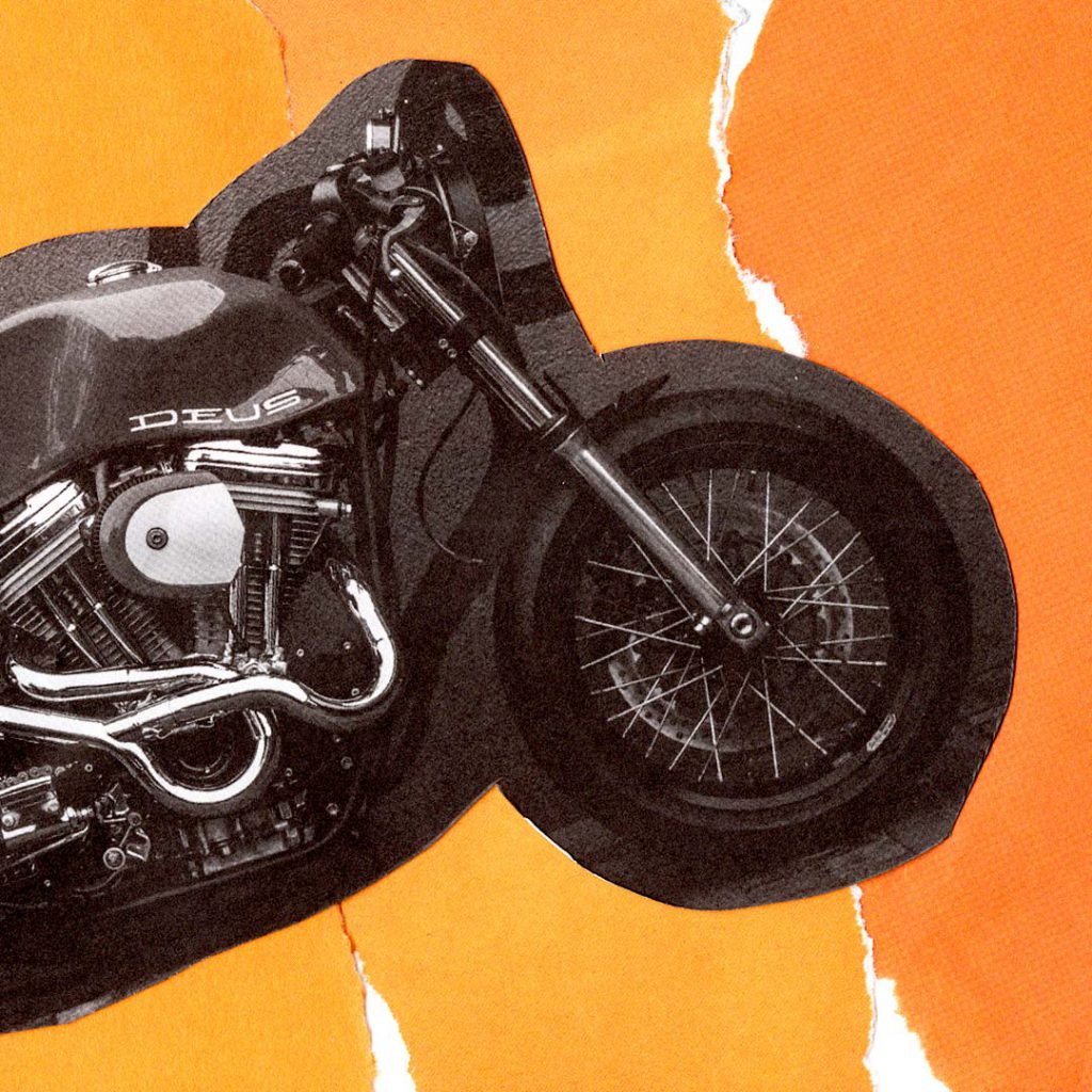 Cut out photo of the front end of a motorcycle on orange background