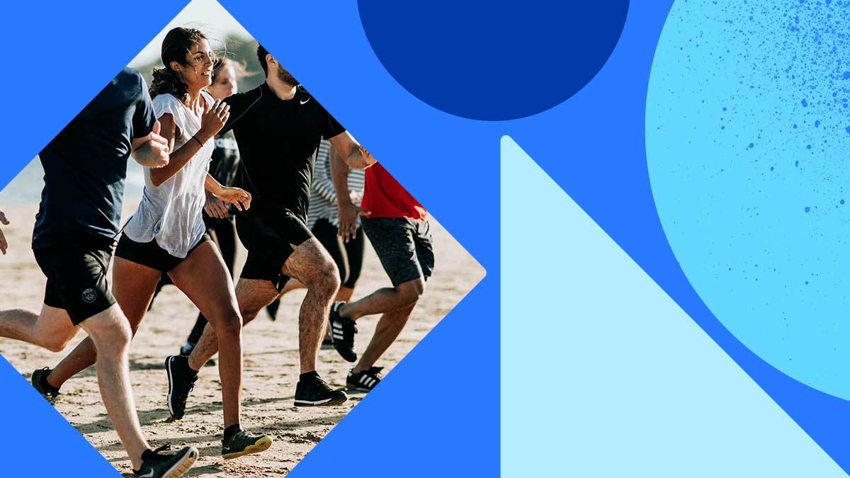 Photo of a woman running competitively with a group. They're running on packed-down sand, like at the beach. The woman wearing a gray shirt with shorts and she looks like she is ready to be done running. The photo is in a diamond shape set on a blue background with blue shapes.
