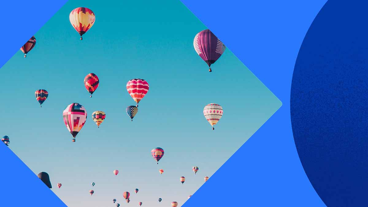 A photo of a fleet of hot-air balloons in the air, against a blue sky. The photo is laid on a blue background with blue shapes.