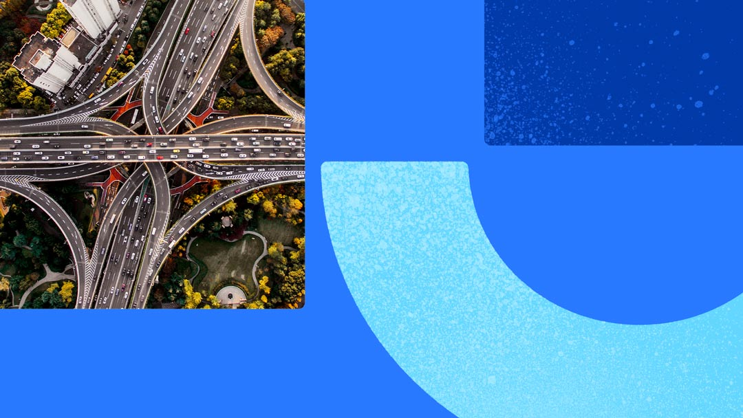 Overhead photo of a busy freeway intersection. Photo is on a blue background with blue shapes.