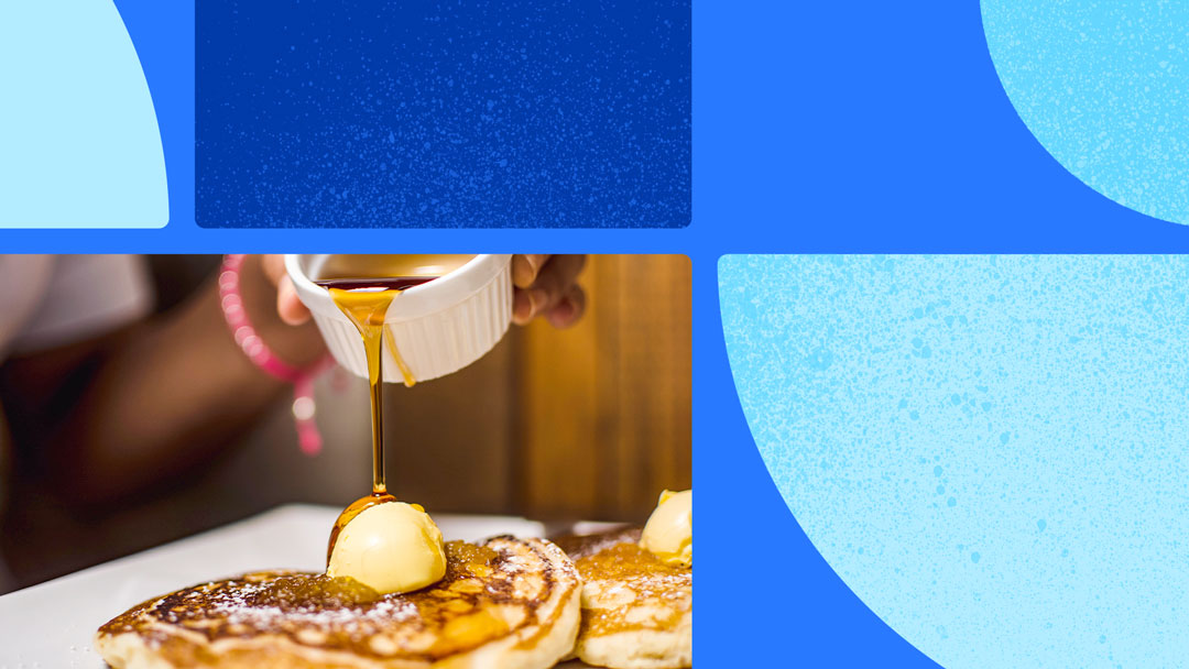 Photo of pancakes with a scoop of butter on top with a hand pouring syrup on the butter. The photo is on a blue background with blue shapes.