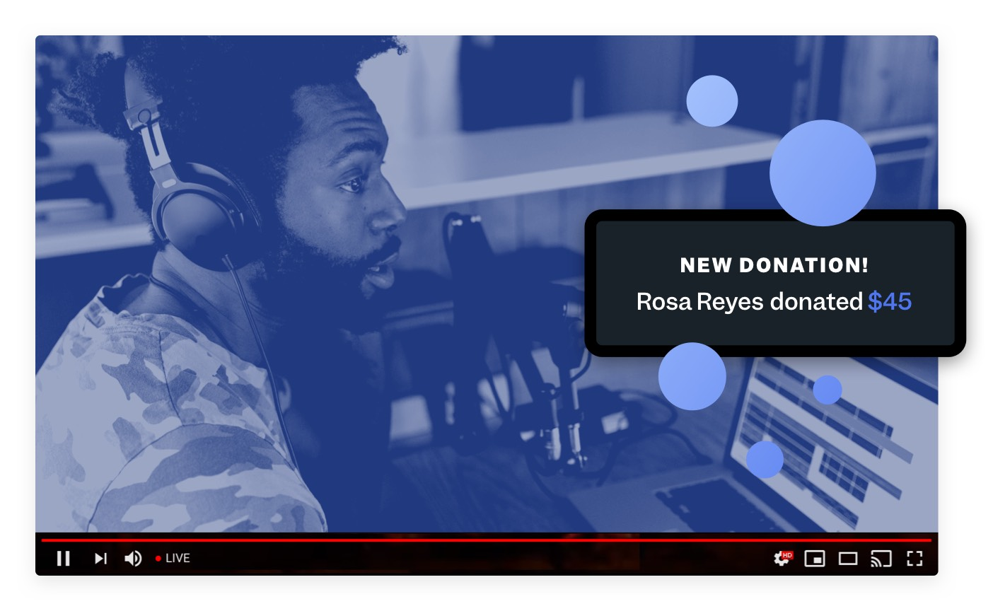 "A livestream video on YouTube shows a man with headphones and a large microphone. Floating over the video is a pop-up that reads ""New Donation!""."