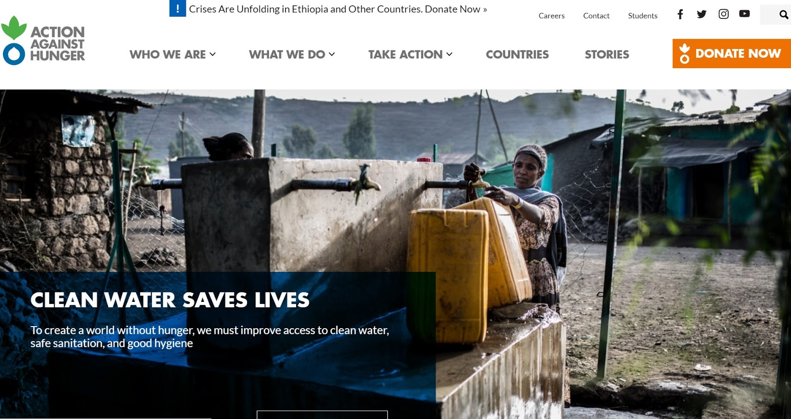 Action Against Hunger homepage with a picture of a woman getting water and a big orange DONATE NOW button in the top right.