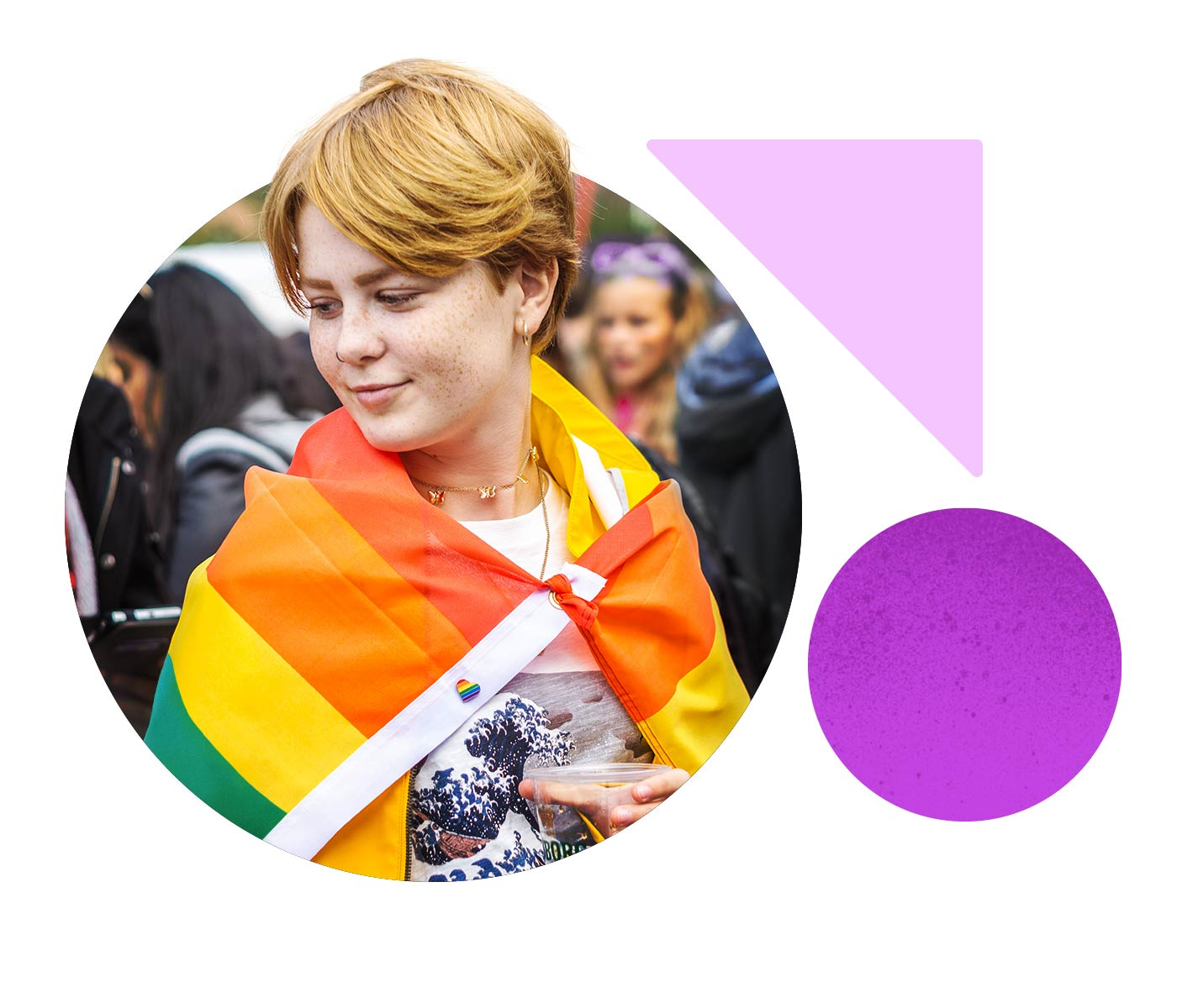 A young woman attends a pride event, draping herself in the rainbow flag.