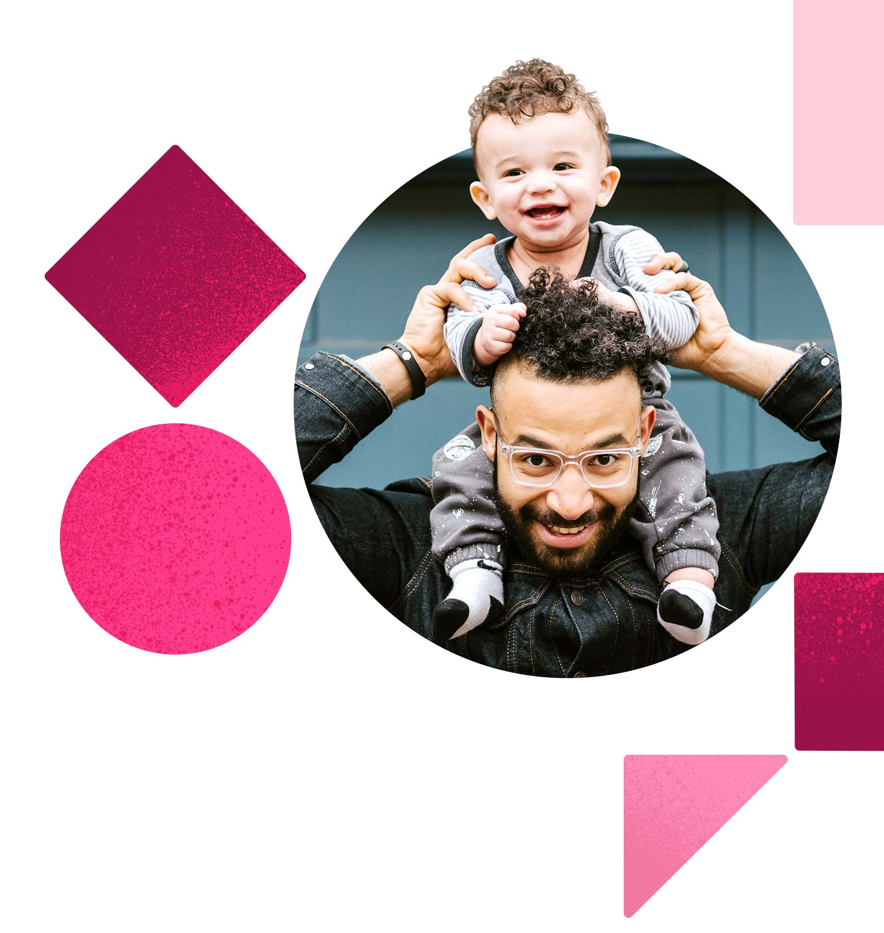 A man holds a giggling kid on his shoulders. Both of them are beaming at the camera joyfully.