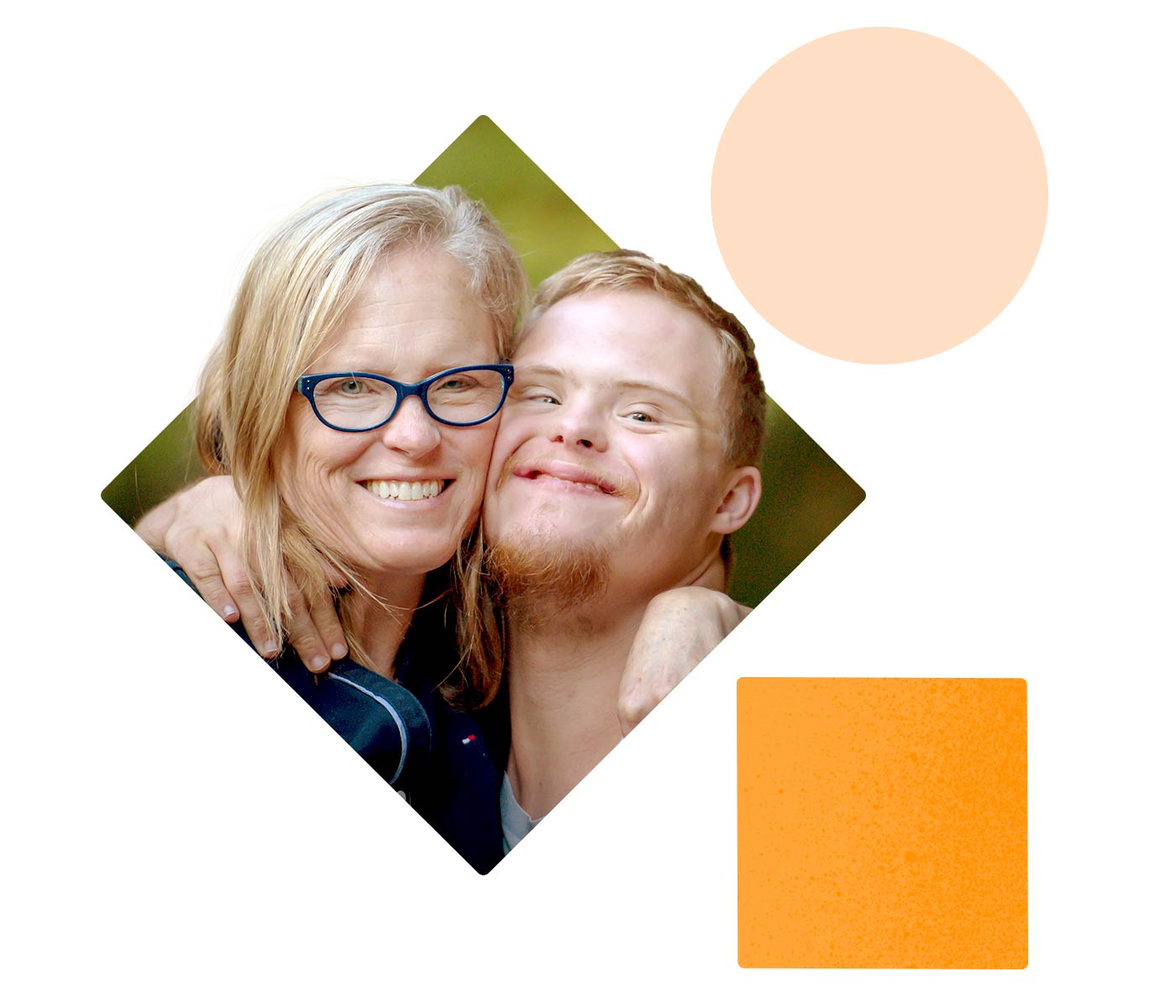 A woman holds her son close as both of them grin at the camera. The son appears to have down syndrome.