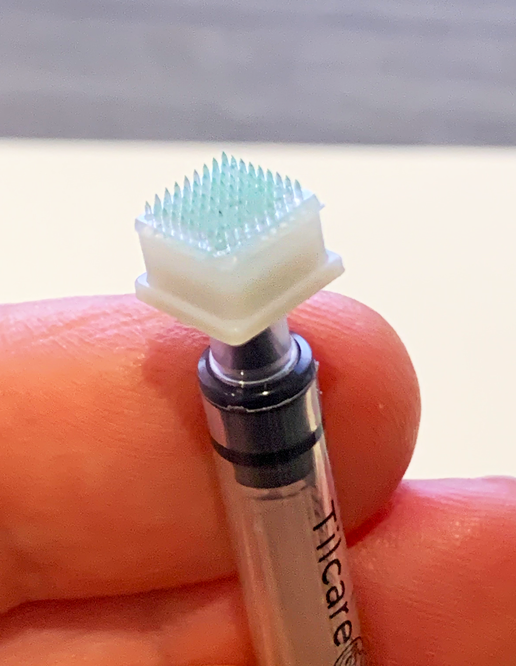 Fabricated-Hybrid-Microneedle-Arrays attached to a syringe with an adaptor