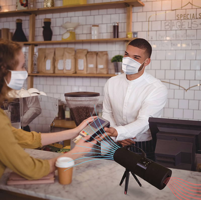 The Nanowave Air device creates a shield of inactivated air between a worker and a customer at a small business.