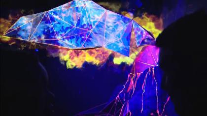 Meow Wolf Kaleidoscape neon cauldron