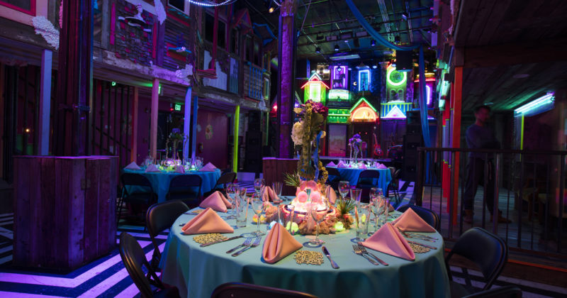 table set for an event at Meow Wolf Santa Fe