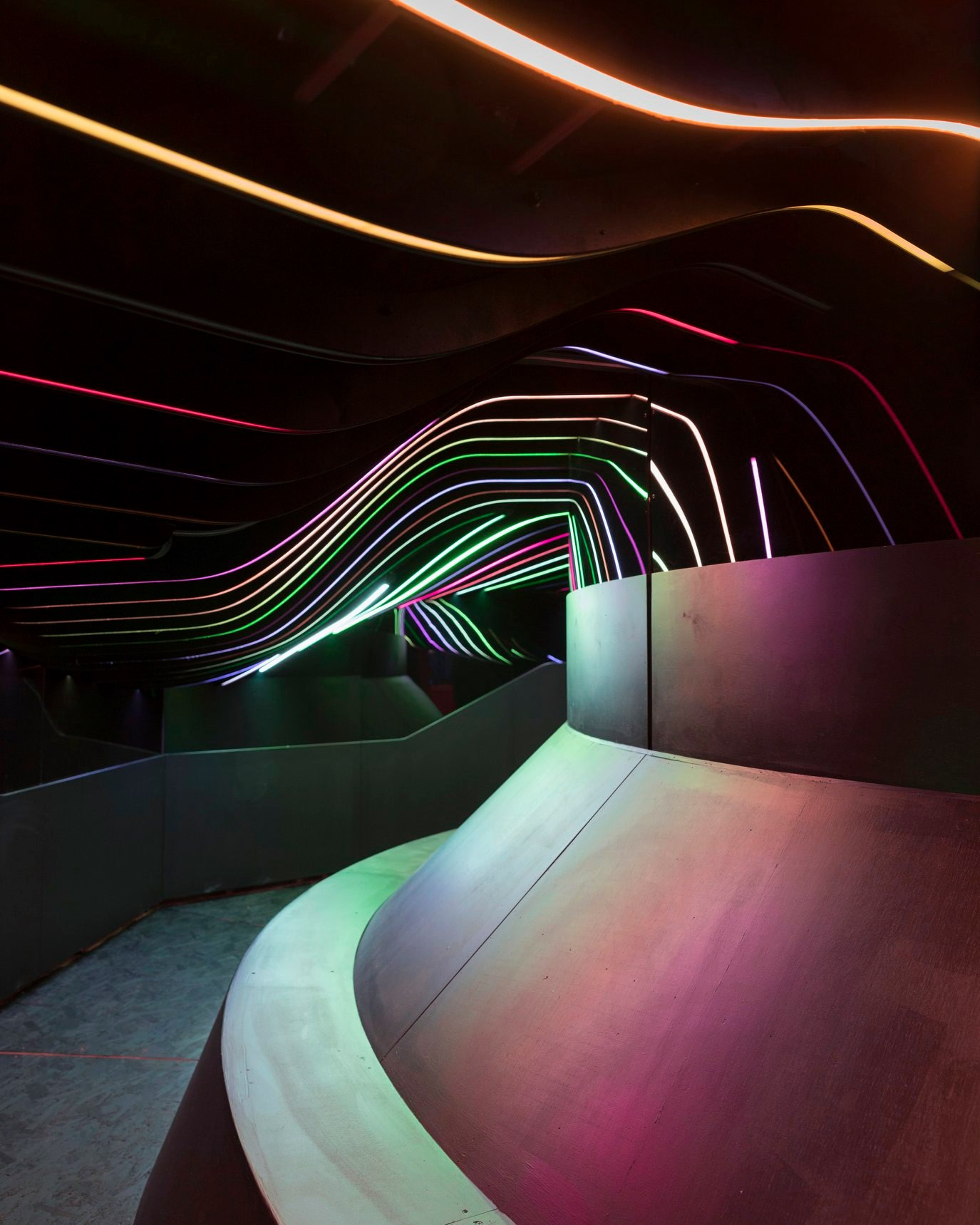 Art exhibit room with neon lighting at Meow Wolf in Santa Fe, NM