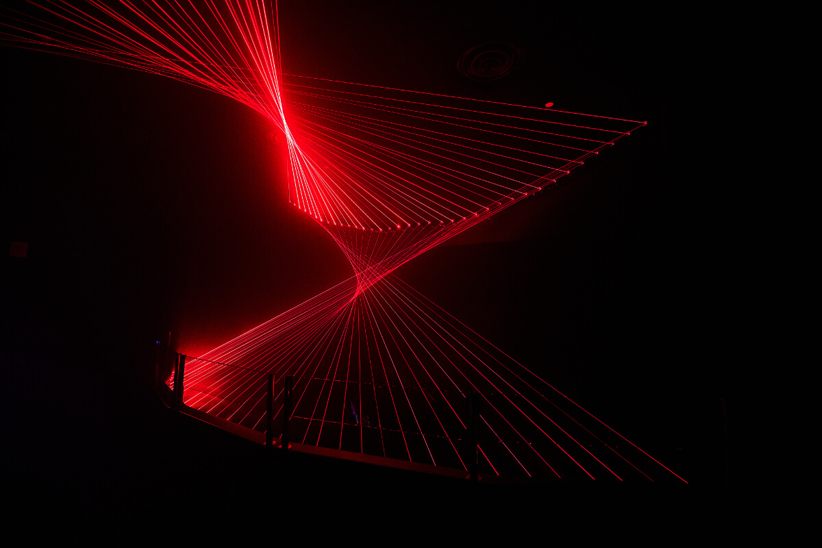 Red neon beams of light in the shape of a DNA spiral | Omega Mart