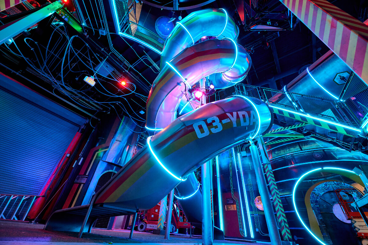 Giant spiral slide with blue lighting | Meow Wolf Las Vegas