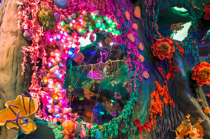 Neon mushrooms, flowers, and fungi inside a swamp inside Meow Wolf Denver's Convergence Station