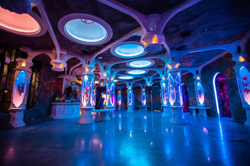 Seemingly endless blue columns with overhead lighting inside Meow Wolf Denver