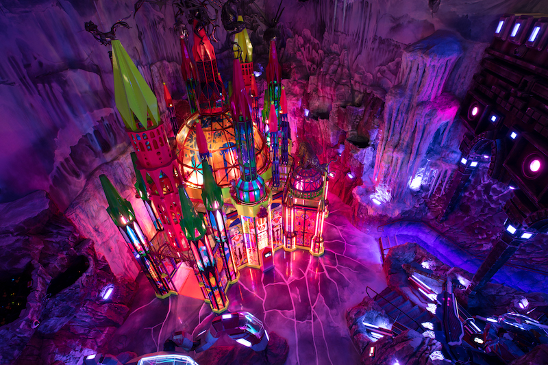 Looking down on an ice castle with pink lighting inside Meow Wolf Denver