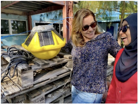 Image 7: Marine Biologist and Spotter deployment expert, Verena Wiesbauer (left), and Swimsol Maldives Office Manager, Rifasa Faiz (right), with the recovered measurement buoy.