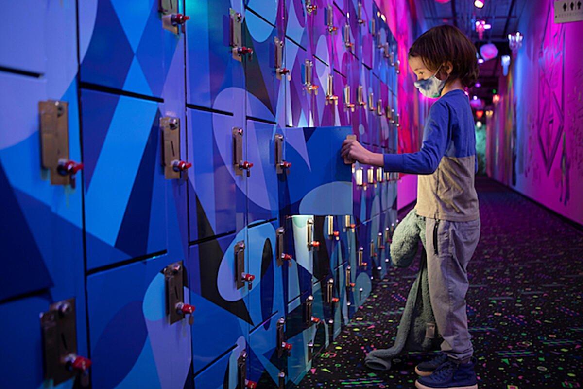 Child opens a lockers at Meow World Santa Fe