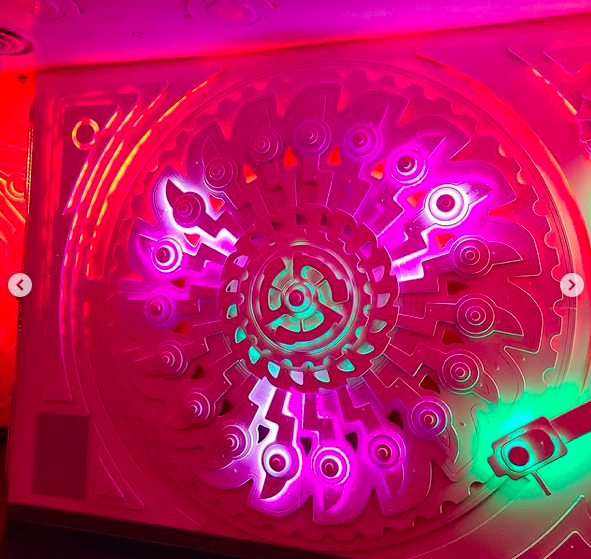 Juke Temple (inspired by Wurlitzer jukeboxes) lit in pink lights