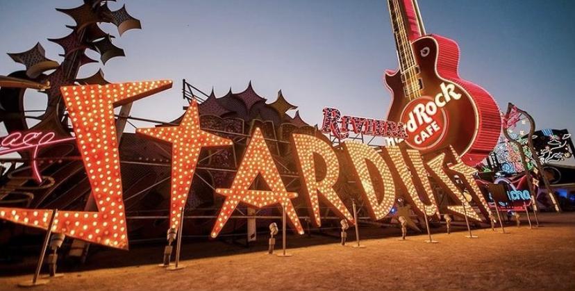 Stardust neon sign near Hard Rock Cafe guitar