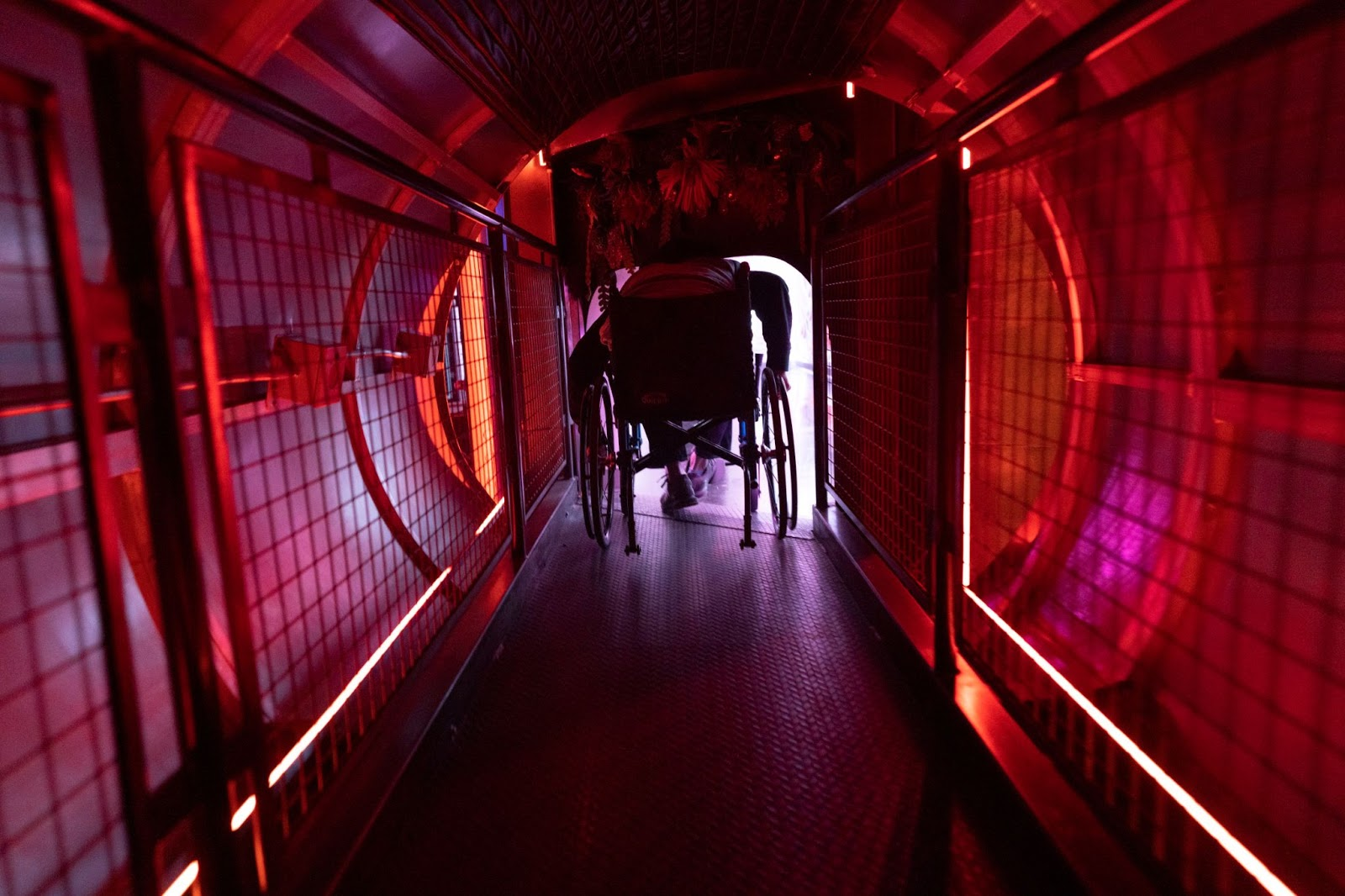 Guest in wheelchair going through tunnel and into Juke Temple
