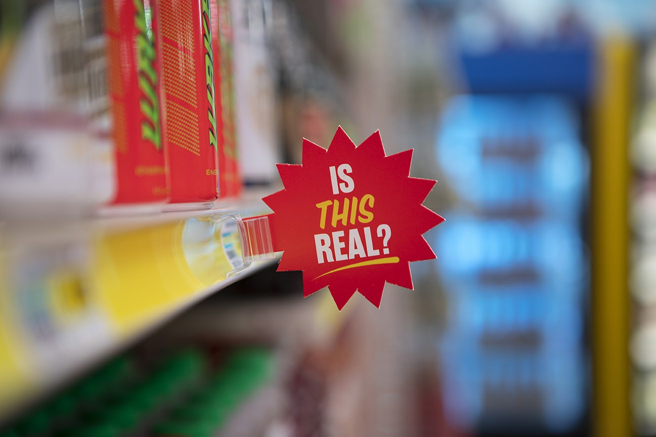 """Sign that reads """"Is this Real?"""" inside of Meow Wolf's Omega Mart"""