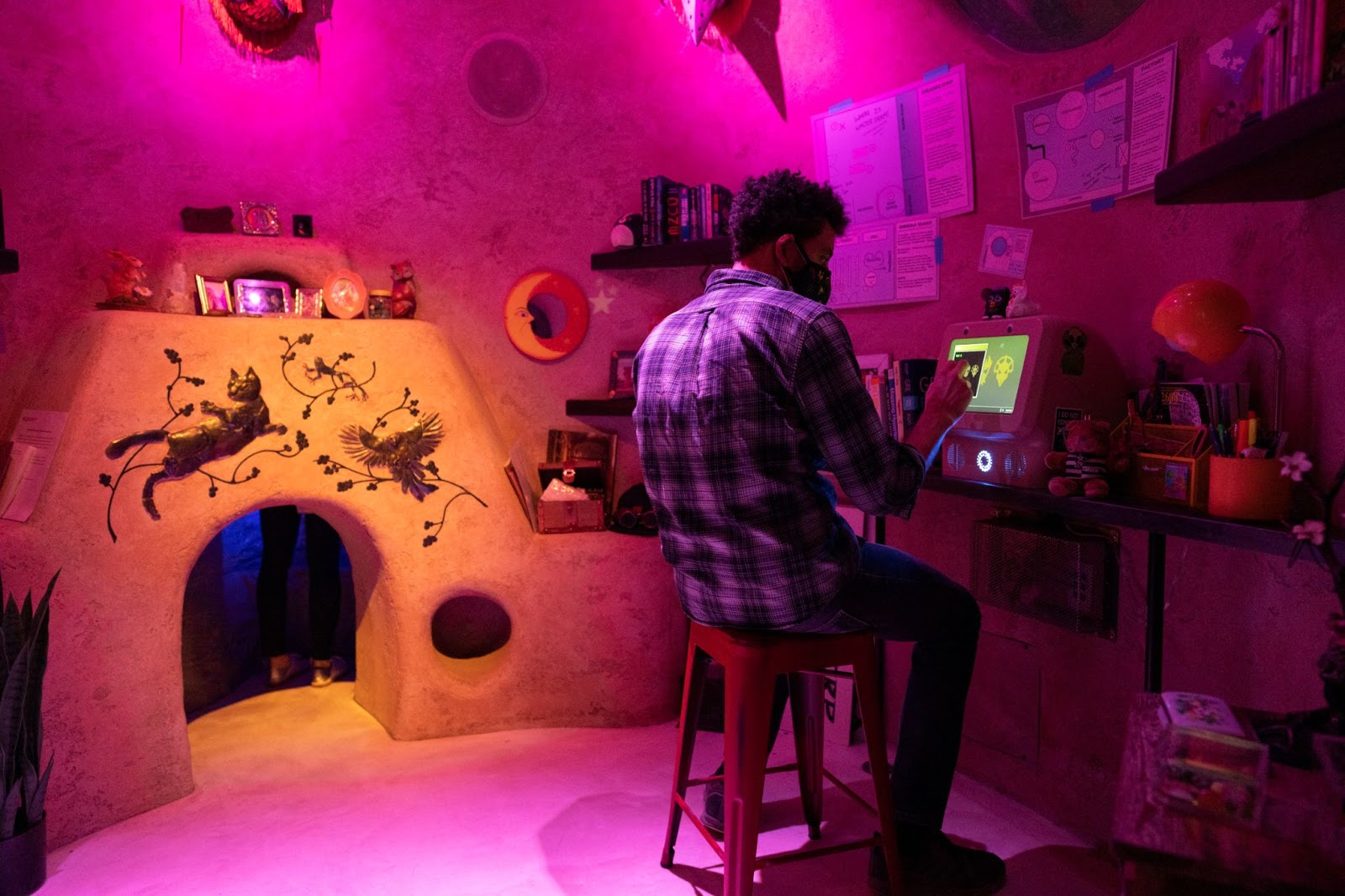 Man sitting at computer inside of small room in Projected Desert