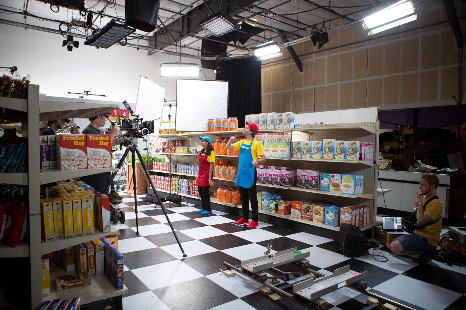 Nate & Hila rapping on the set of Omega Mart's 'Employee Training' videos.