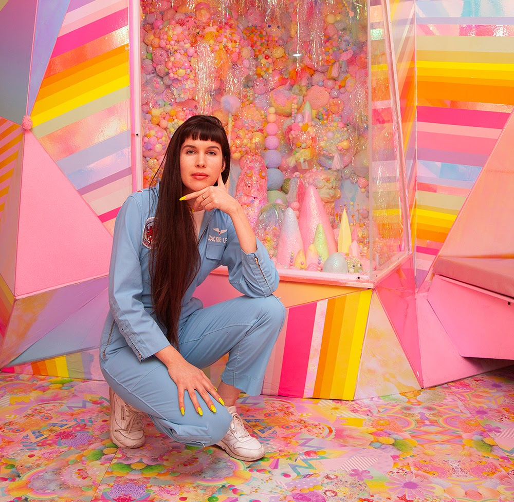 Meow Wolf's Director of Artist Collaboration in front of a room at the House of Eternal Return
