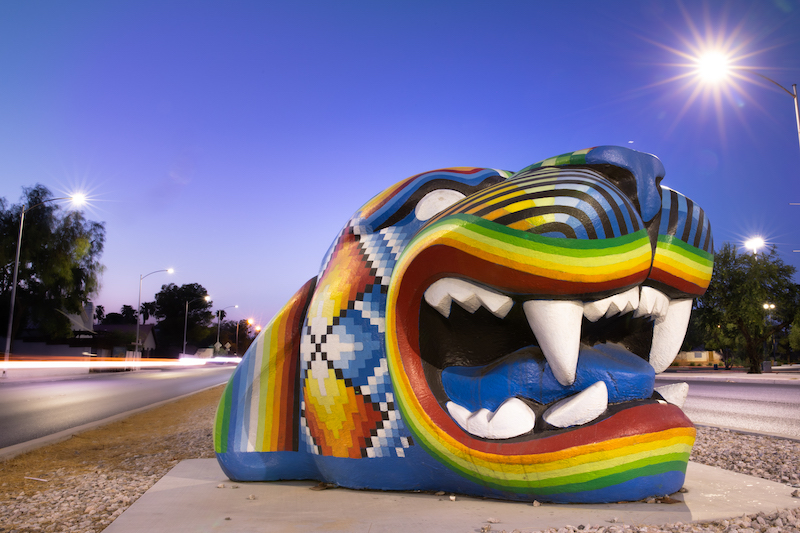 Up close of Gato Gigante, a large jaguar head in multi colors